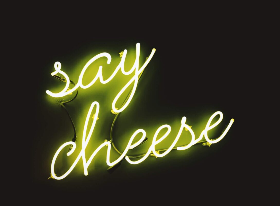 Say cheese text in neon lights